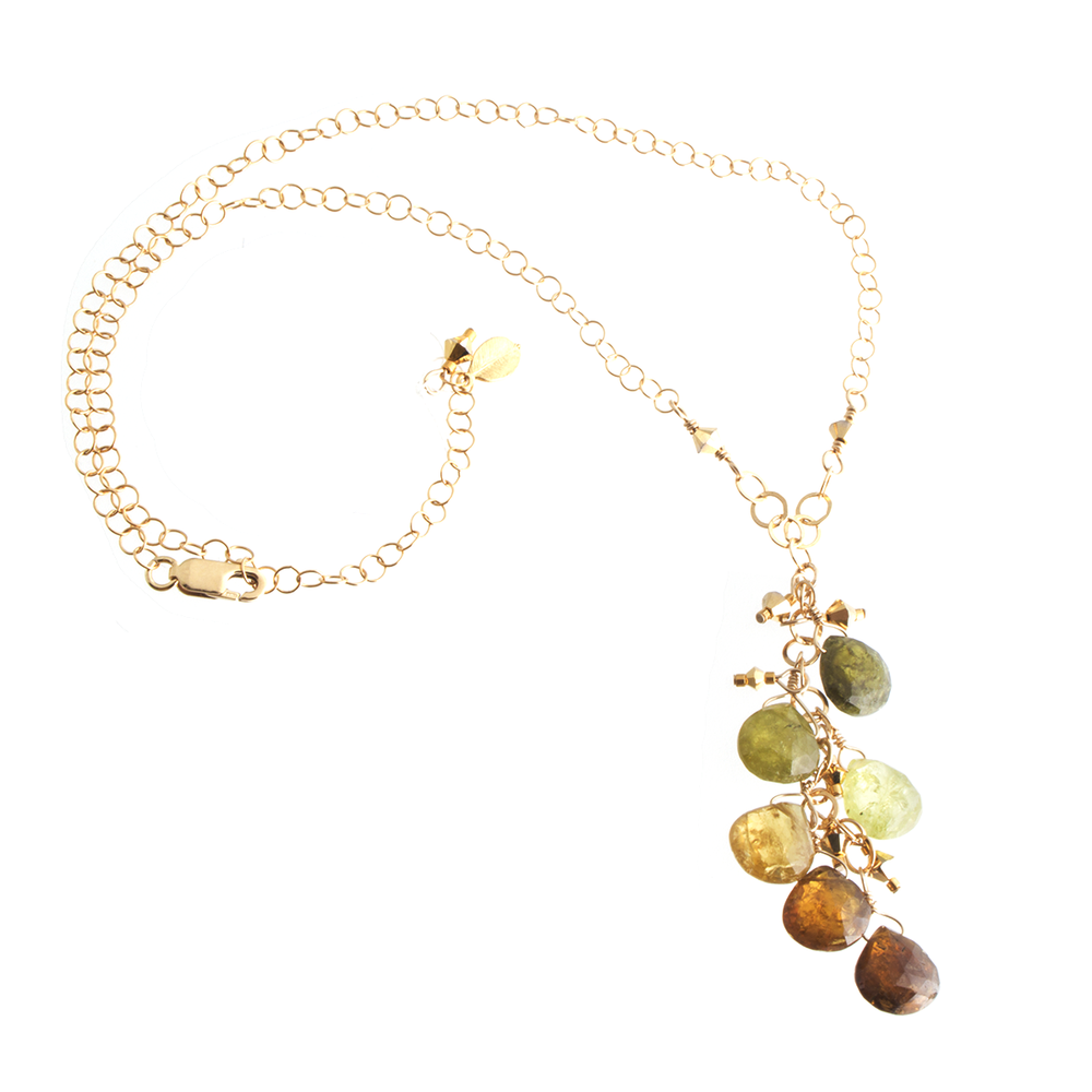 Grossular Green Garnet--seen here in Amy's lovely cascade-style necklace--ranges in hue from warm brown to vibrant green.