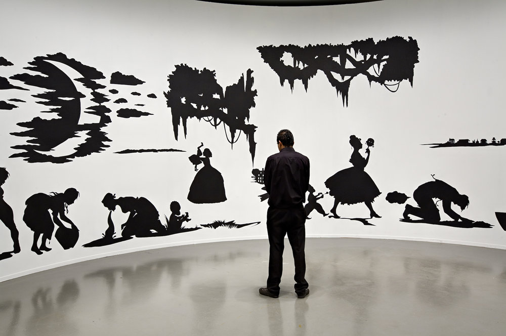 "Kara Walker,  Slavery! Slavery! Presenting a GRAND and LIFELIKE Panoramic Journey into Picturesque Southern Slavery or ""Life at 'Ol' Virginny's Hole' (sketches from Plantation Life)"" See the Peculiar Institution as never before! All cut from black paper by the able hand of Kara Elizabeth Walker, an Emancipated Negress and leader in her Cause , 1997. Cut paper on wall, approx. 144 x 1,020 inches. ARC/Musée d'Art moderne de la Ville de Paris, 2007. Photo: Florian Kleinefenn"