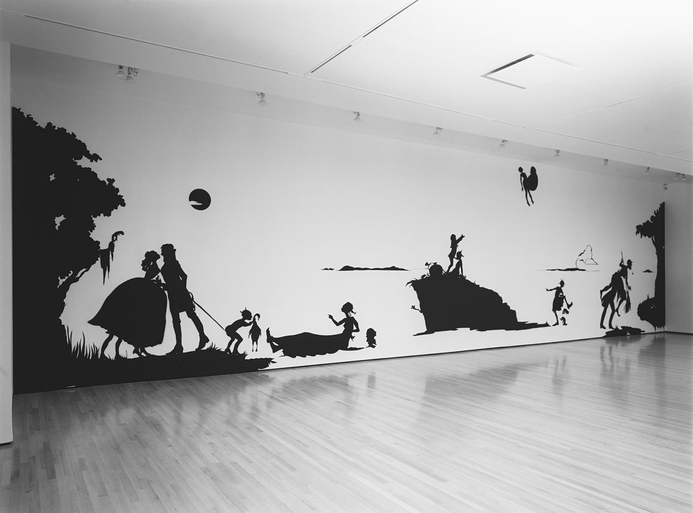 Kara Walker,  Gone, An Historical Romance of a Civil War as it Occurred between the Dusky Thighs of One Young Negress and Her Heart , 1994. Cut paper on wall, approx. 156 x 600 inches. The Drawing Center, New York, 1994. Photo: Orcutt Photo
