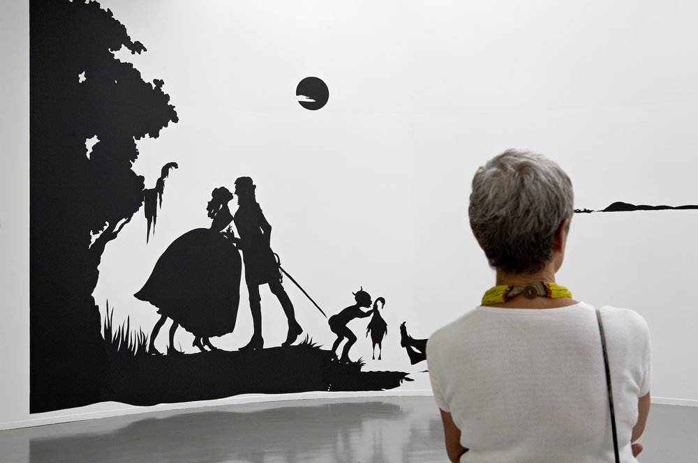 Kara Walker,  Gone, An Historical Romance of a Civil War as it Occurred between the Dusky Thighs of One Young Negress and Her Heart , 1994. Cut paper on wall, approx. 156 x 600 inches. ARC/Musée d'Art moderne de la Ville de Paris, 2007. Photo: Florian Kleinefenn