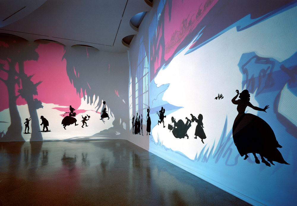 Kara Walker,  Insurrection! (Our Tools Were Rudimentary, Yet We Pressed On) , 2000. Cut paper and projection on wall, approx. 144 x 870 inches. Solomon R. Guggenheim Museum, New York, 2002. Photo: Ellen Labenski
