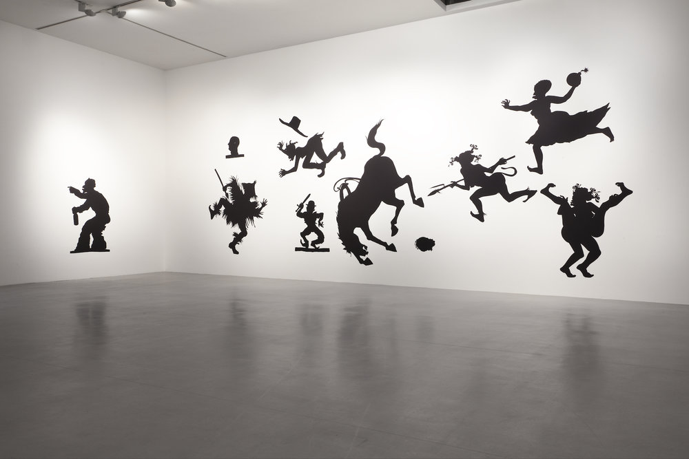Kara Walker,  Auntie Walker's Wall Sampler for Savages , 2013. Cut paper on wall, approx. 132 x 408 inches. Camden Arts Centre, London, 2013. Photo: Angus Mill Photography