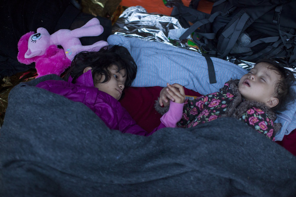 Who is the Refugee_ Refugees sleep while waiting for daylight after arrival on the Greek island of Lesbos. Photo by Ron Haviv.jpeg