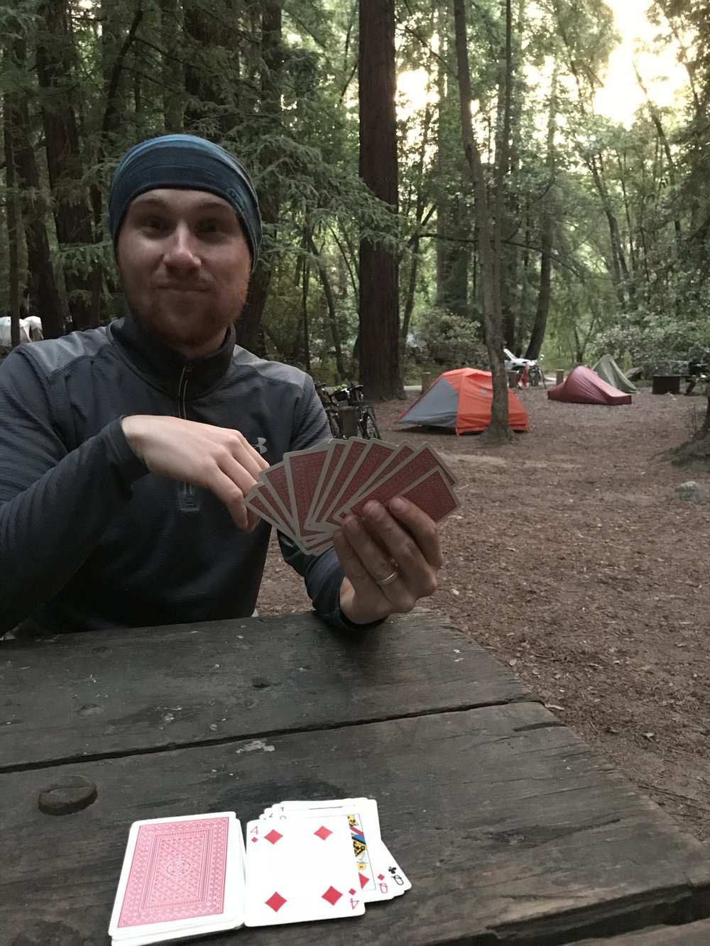 Getting ready for bed with some rounds of gin rummy. The hike/bike site at Big Sur State Park was beautiful - right inside a grove of redwoods.