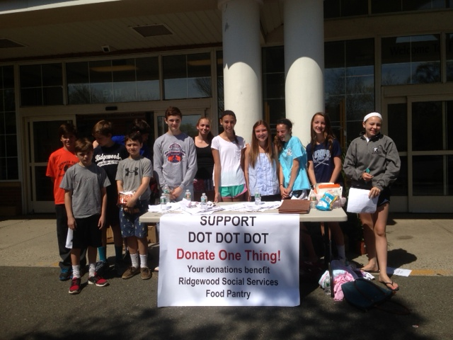 This is a photo of the DOT DOT DOT (donate one thing) food drive that took place last week at the A&P in Midland Park to benefit Ridgewood Social Services. Founded by high school student Jack Trevisan, DOT DOT DOT volunteers included seventh graders from George Washington middle school. The day was a huge success!