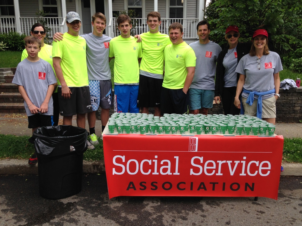 Social Service Association volunteers helping out at the 2015 Ridgewood Memorial Day Run.