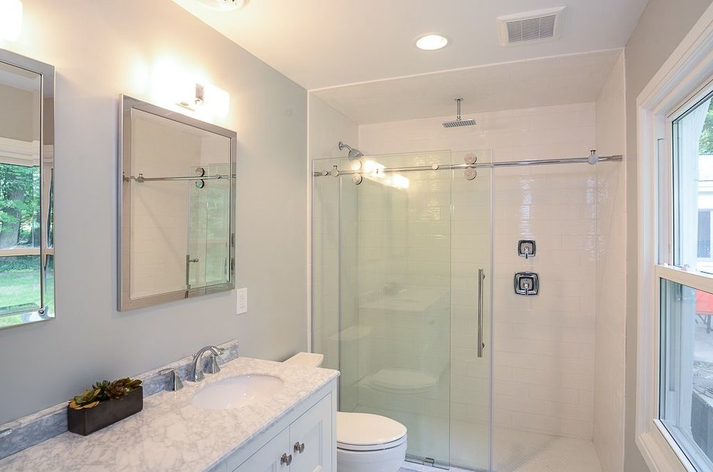 Double Marble Top Vanity with modern Barn Door shower