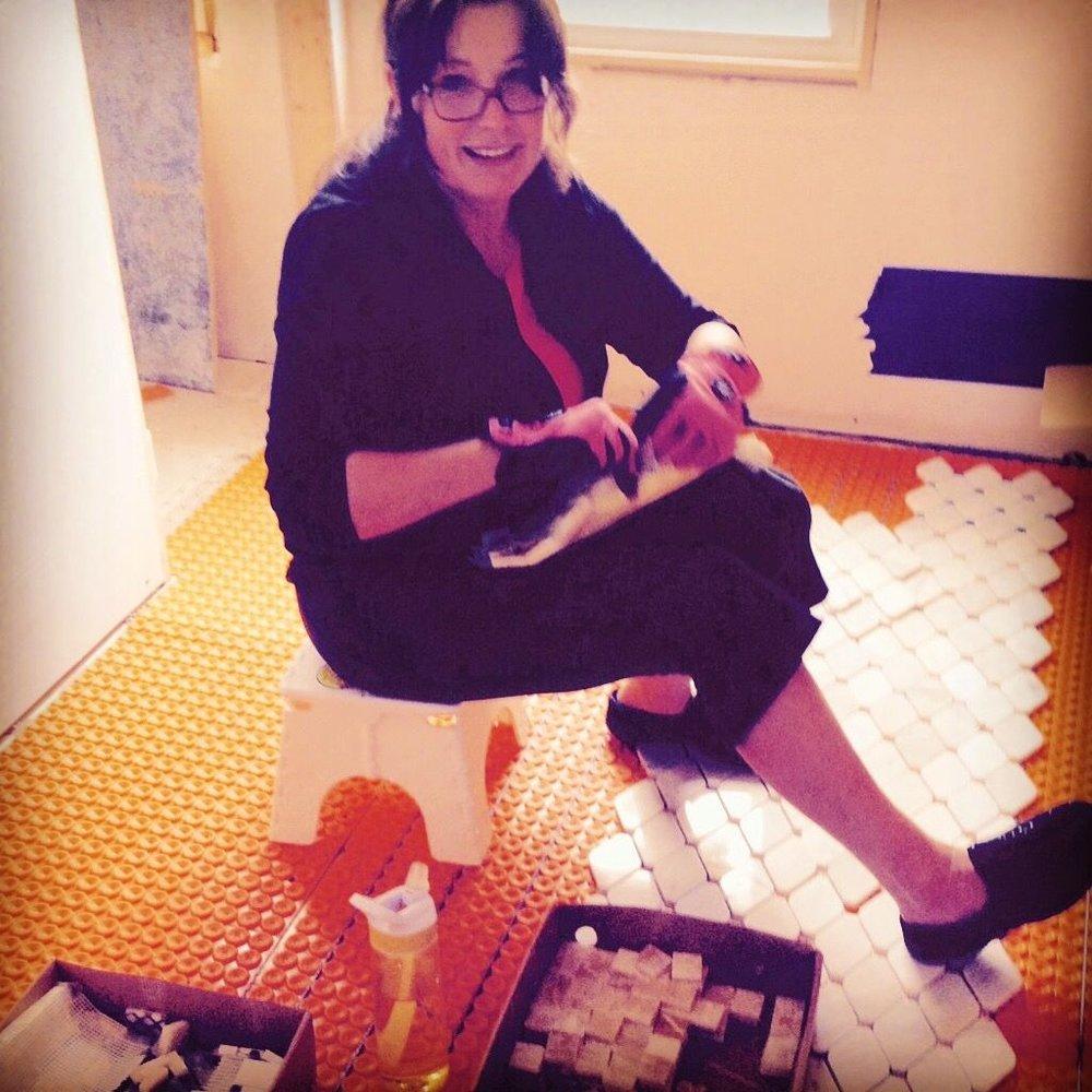 Hand Setting the marble & onyx floor 'carpet'