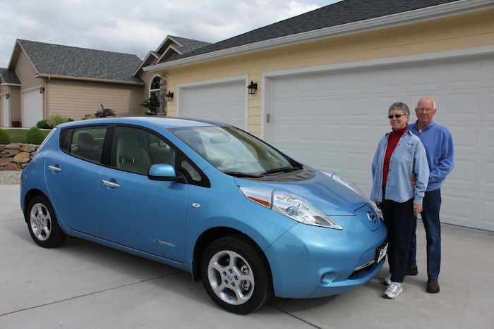 Pauline and John Sweeney with their all-electric Nissan Leaf.