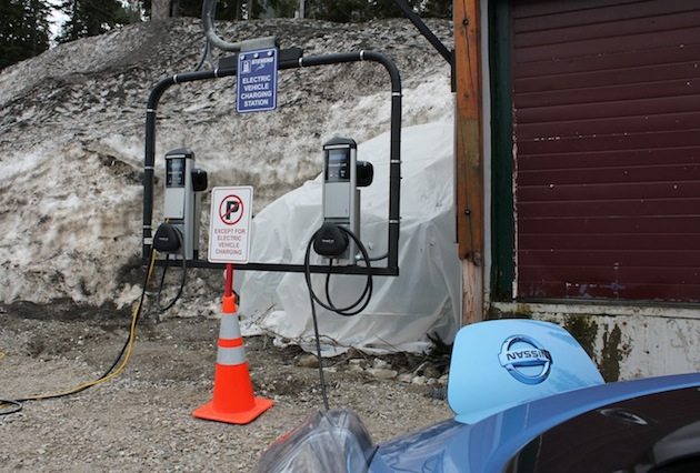 An all-electric Nissan LEAF charges up at the first charging stations to be installed over a mountain pass in the United States.