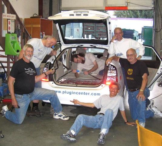 Helping convert the Prius were, from the left: Steve Lough, Rich Rudman, Ryan Fulcher (in   car), Jim White, Blake Murray, and Ron Johnston-Rodriguez (sitting). Other volunteers not pictured include: Mike Brogan, Randy Brooks, Larry Epperson, Doug Janke, Jake Lodato, and Aimee Pope.