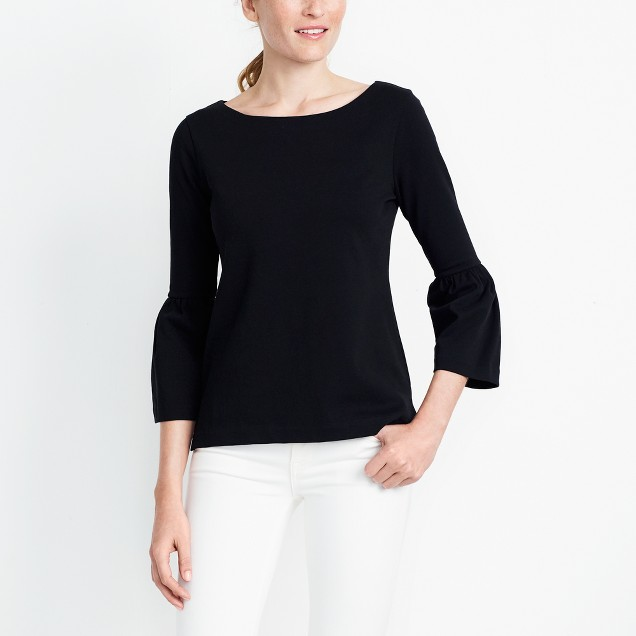The belle sleeves dress up  this  classic black top.