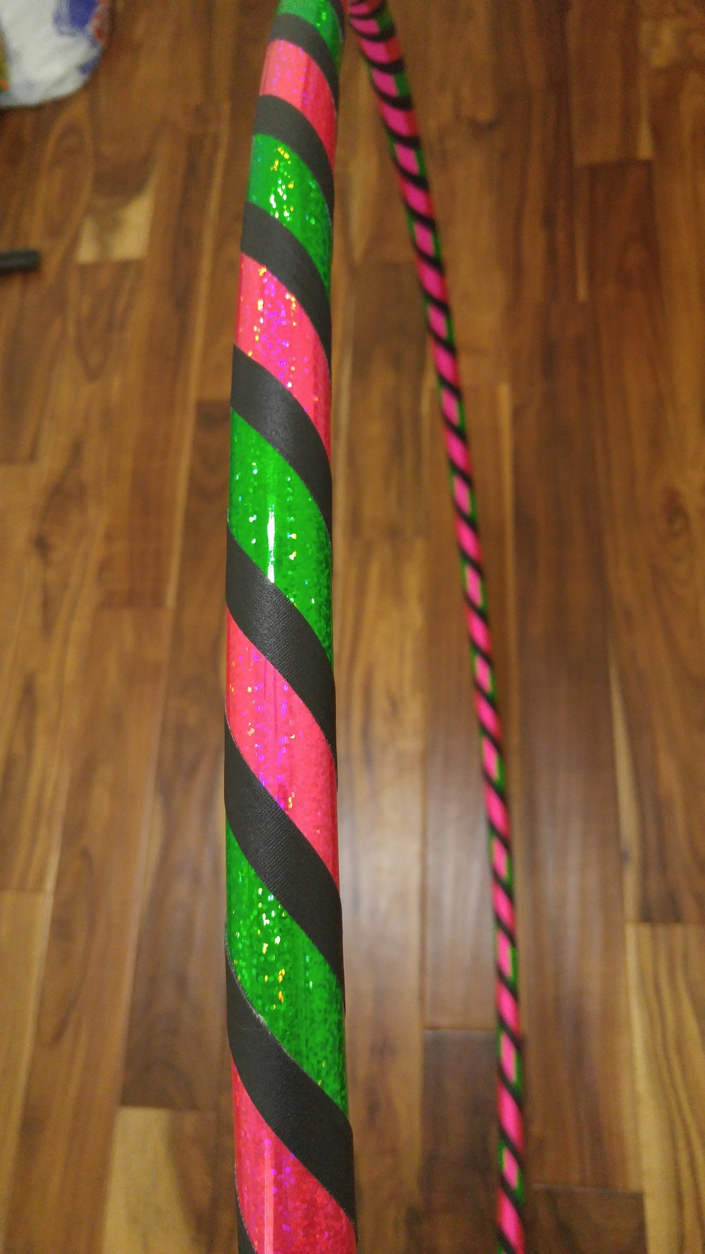 Green & Pink sparkle with black accent grip.