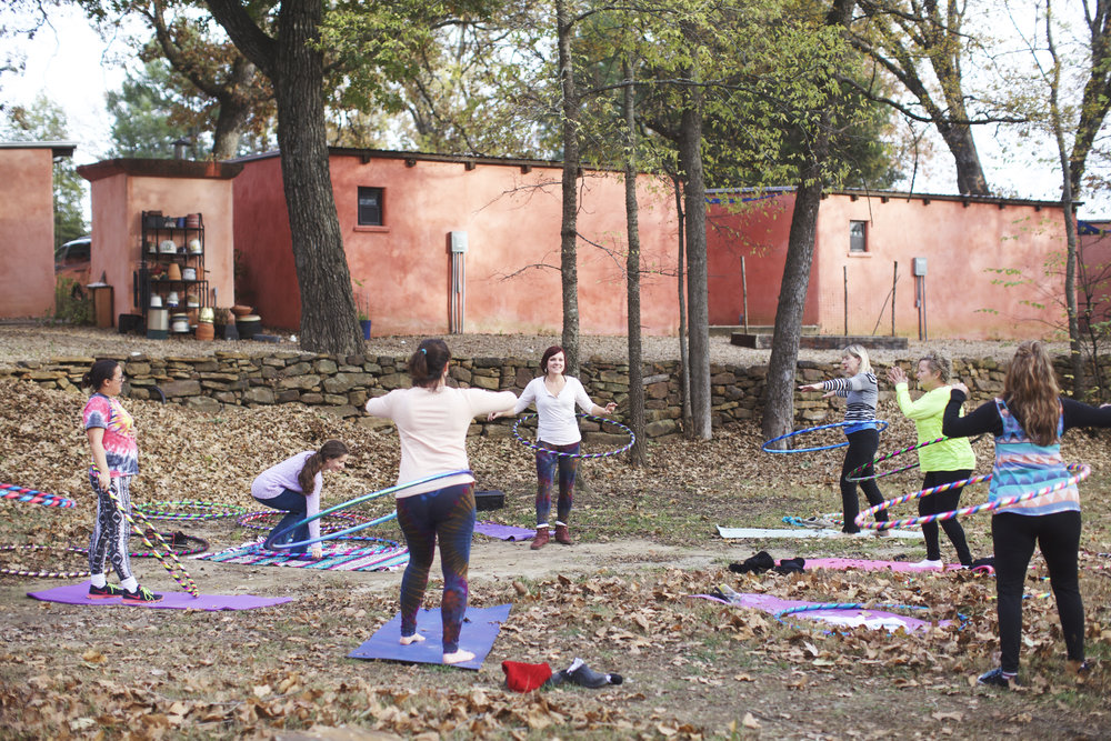 Kelsey teaching hoop class at the you are venus retreat at beautiful blue doors at tenkiller