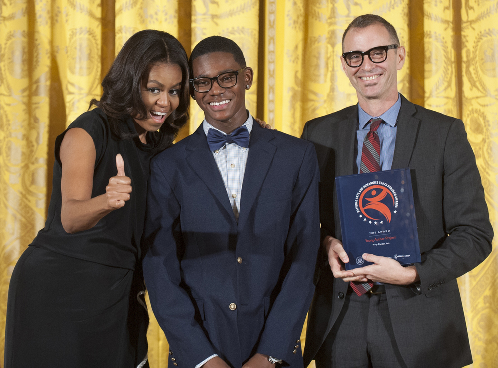 Deep Center Poet André Massey and Executive Director Dare Dukes with First Lady Michelle Obama