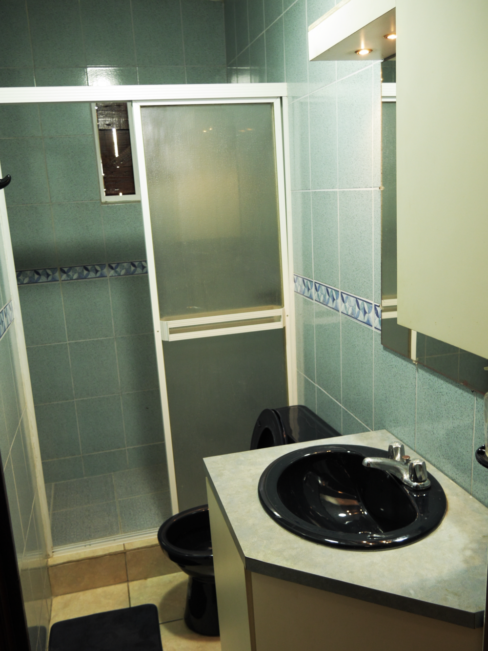 The spacious bathroom tiled in a caribbean fashion.