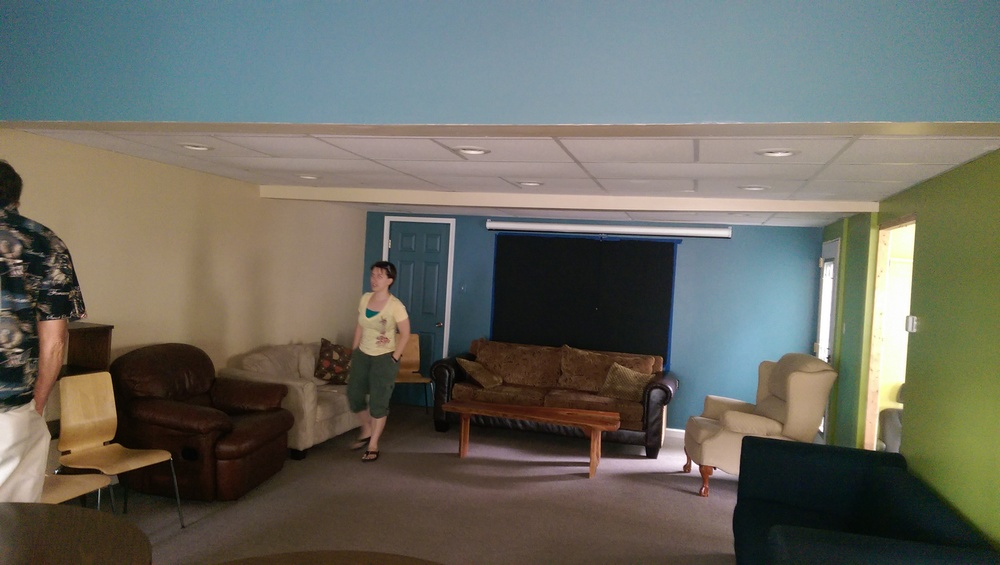 A newly redone Lounge area under Boys Dorm.  New paint, new carpet, new furniture.