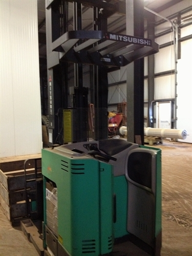 """MITSUBISHI REACH FORKLIFT MODEL ESR36 . Electric Motor, 250"""" raised triple mast and side shift. Good battery, foot tires, capacity 3500 lb. Bought used and was not able to use it in our building. The mast is too high for our storage rooms. $5500 or best offer."""