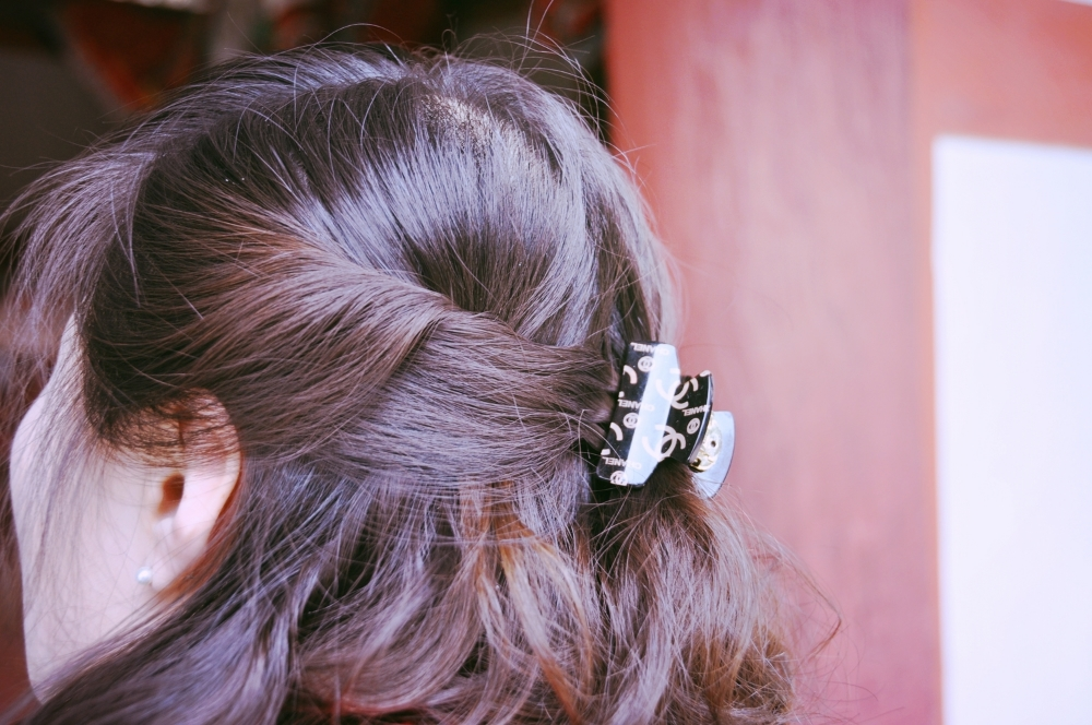North Korean Woman Wearing Chanel Hair Clip.JPG
