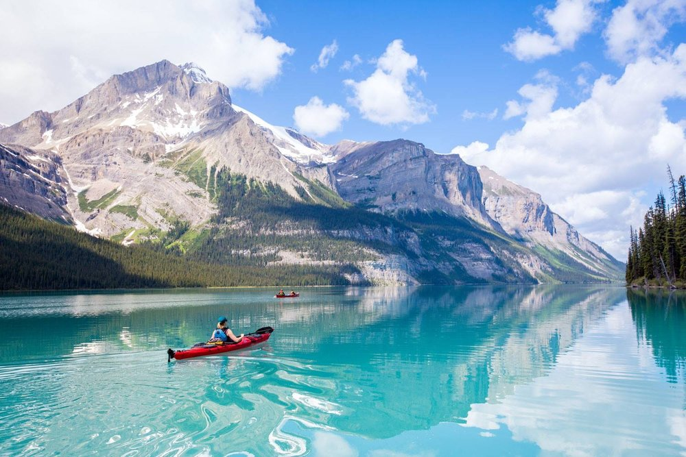 Canoeing or Kayaking in one of the crystal clear Lakes