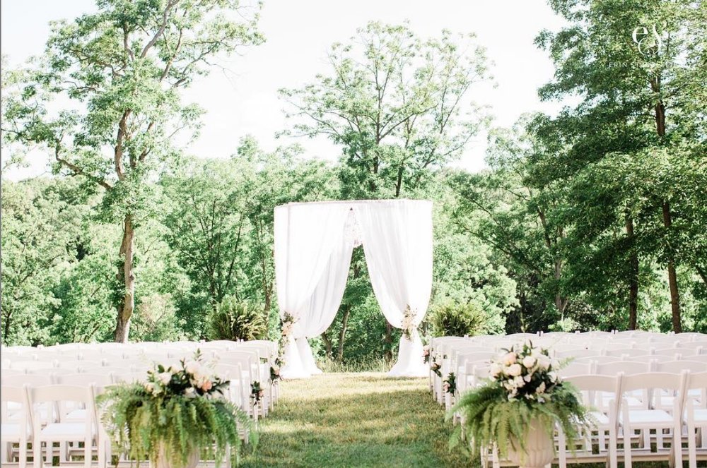 facing the woods - Treat your guests to a ceremony overlooking our 28 acre estate. Throughout the year your backdrop is always a breathtaking reflection of Missouri's seasons. You may choose to have all chairs on the grass, all on the patio, or split between the two. Approx. total chairs: 280 with 10 rows