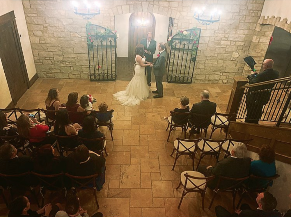 lower foyer - The foyer is not only an impressive spot to visit for cocktail hour, but a beautifully crafted ceremony space as well. Our wine cellar offers a touch of french romance by spotlighting your vows beneath its stone archway, framed by its wrought iron gates. Approx. total chairs: 60 with 6 rows