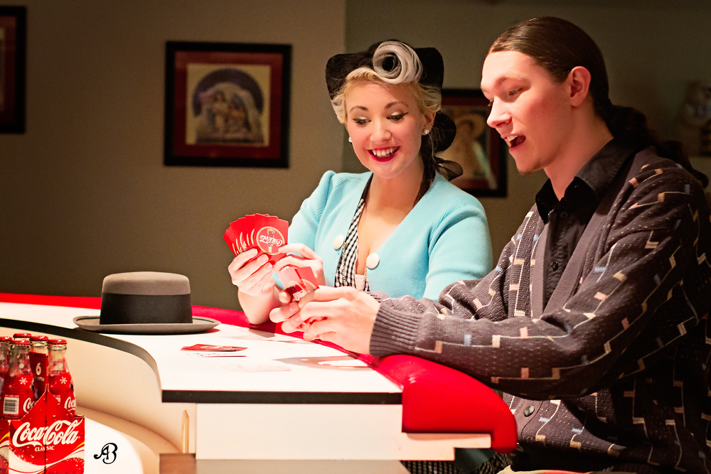 Pinup couple playing cards
