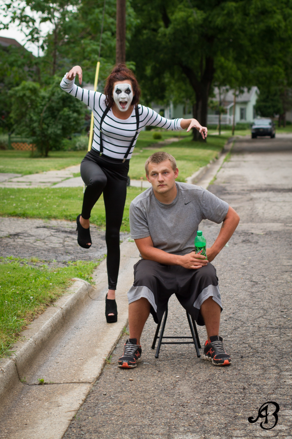 Taryn the mischievous mime sneaks up on her very bored friend, while a cop car creeps closer in the background to investigate what shenanigans we were up to.  Model: Taryn Alyssa    |    Hair & Makeup: Andrea Menke    |    Video: Krissy Booth    |    Photographer: Alyssia Booth
