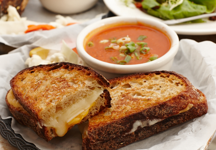Grilled Cheese with pecorino, aged sharp cheddar, and Provolone on thick cut Banshee Tuscan white with a side of tomato soup