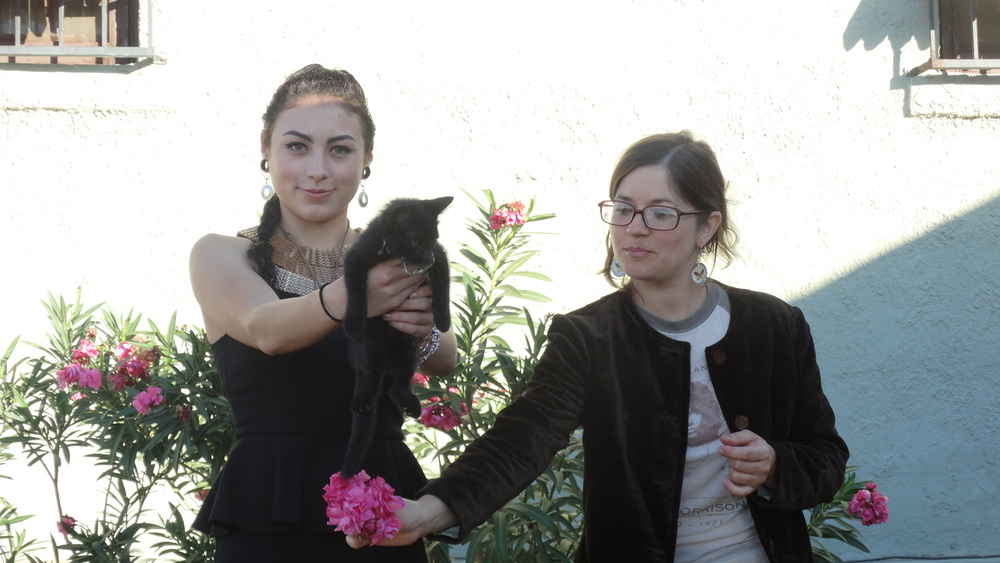 Winona (left) Stella (right) making offerings of cat and flowers.