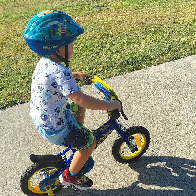 He's four today! FOUR!! That's big!!!! New bike and he's off xx