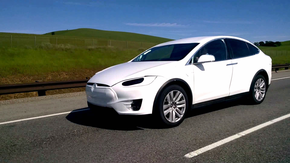 Tesla Model X Prototype with a grille bump underneath the white cover.