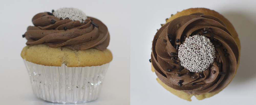 Chocolate Top  - Our moist vanilla cake topped with chocolate buttercream, chocolate sprinkles, and a nonpareil topper.