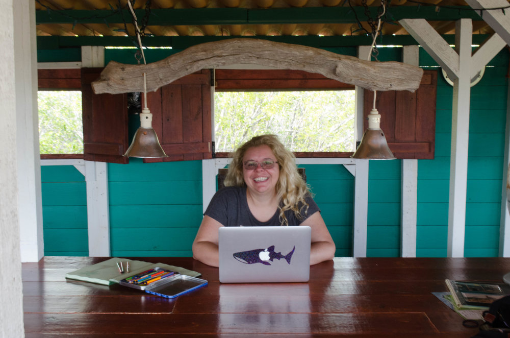 Writing in Bonaire, Photo Credit: Neil DeMaster, 2016
