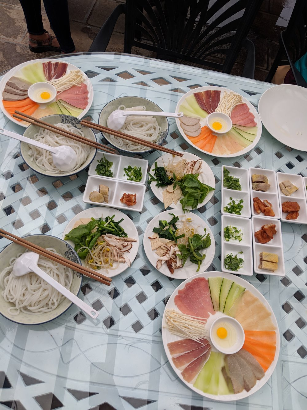 The spread of vegetables and meats for our Across the Bridge Noodles.