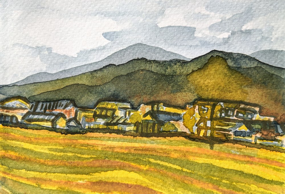 Zhoucheng Village, painted with indigo dye, gardenia dye and soil from the Cangshan Range behind the village.