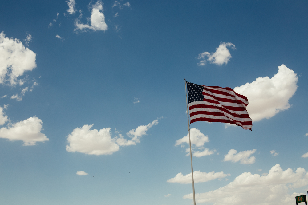 An American flag waves proudly over a Tucson, AZ business.