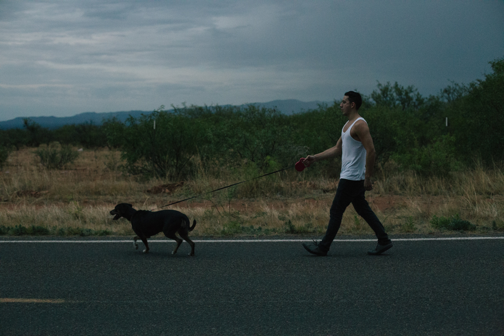 My cousin Derek takes a walk with my other cousin's dog before a big thunderstorm.