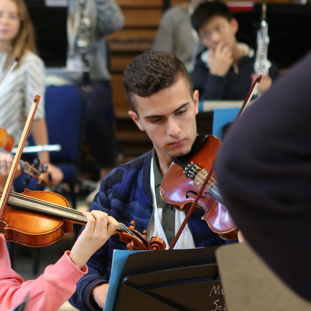 Haroun in orchestral rehearsal at the Ingenium Academy