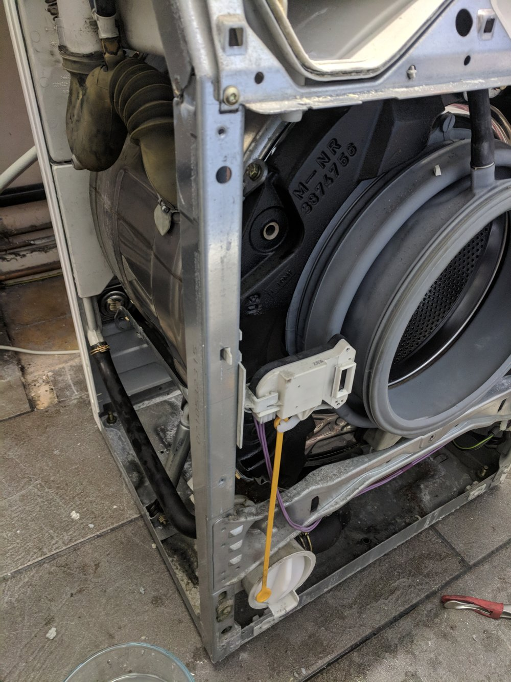 A Miele washing not draining machine. We stripped the machine to find a blockage stopping the machine from draining. The bill for this job was £49.