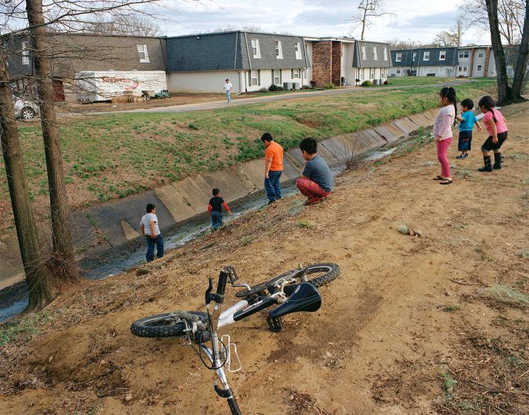 Kids playing around sewage creek, 2014.