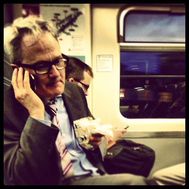 Food on the go…London style. #fastfood #trains #man #phone #london #commuting
