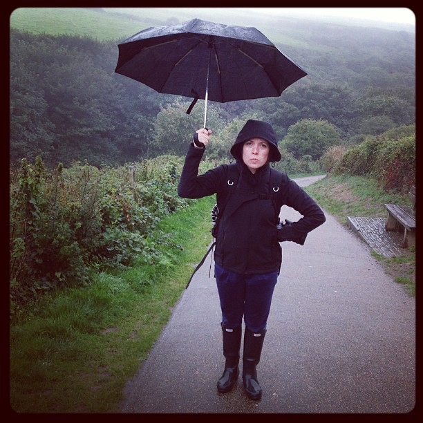 Summer is officially over!!!… Only a bit wet lol. #tintagel #walking #umbrella #roadtrip #september #England #Cornwall #travel #countryside