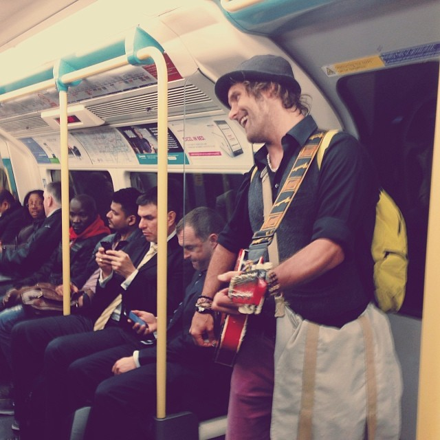 Happiness strikes the tube!…How to Londoners react?… #london #uk #underground #tube #buskers #travel #commuters #music #musician #people #photography #happy #singer