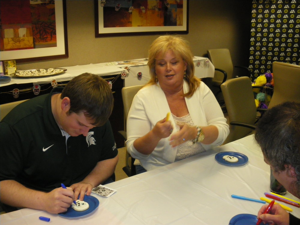Sheryl Simmons trying to open the cookie decorating marker - it's complicated!.jpg