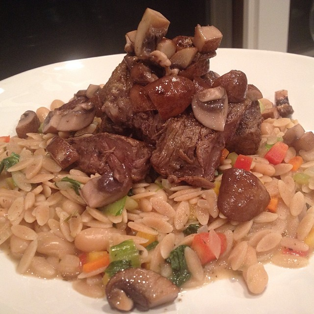 Beef short ribs and shrooms over wheat orzo pasta salad - #empoweredwellness #integratemorewholefoods