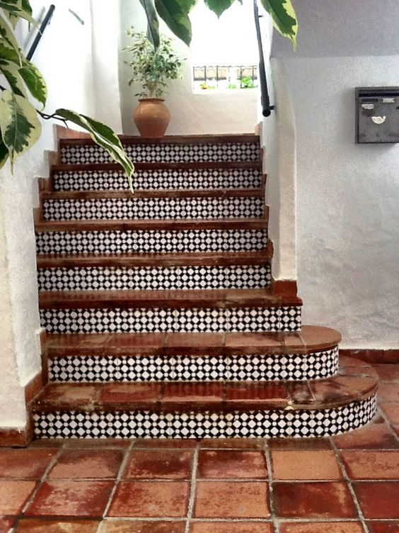 Mix + match terra cotta and funky tile to create a more European look. (designspiration.net)