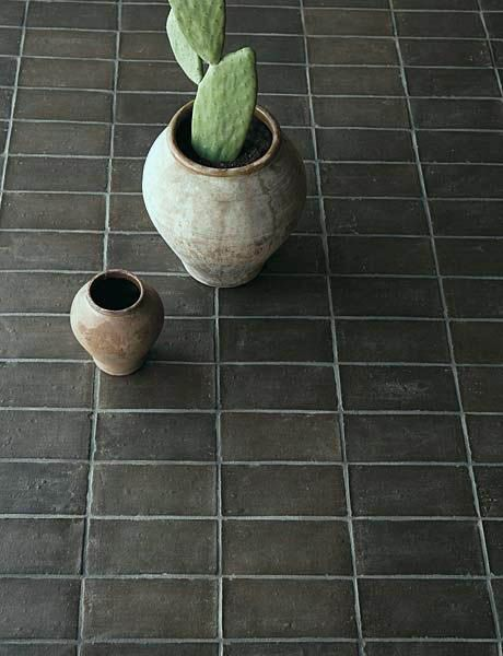 Stunning black terra cotta tile from xsurfaces.com. I'd do a whole covered patio of this in a heartbeat!