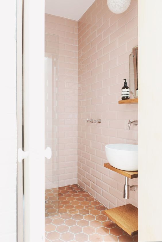 Vintage pink subway tile is so perfect with this terra cotta hex! (Dustjacket Attic)