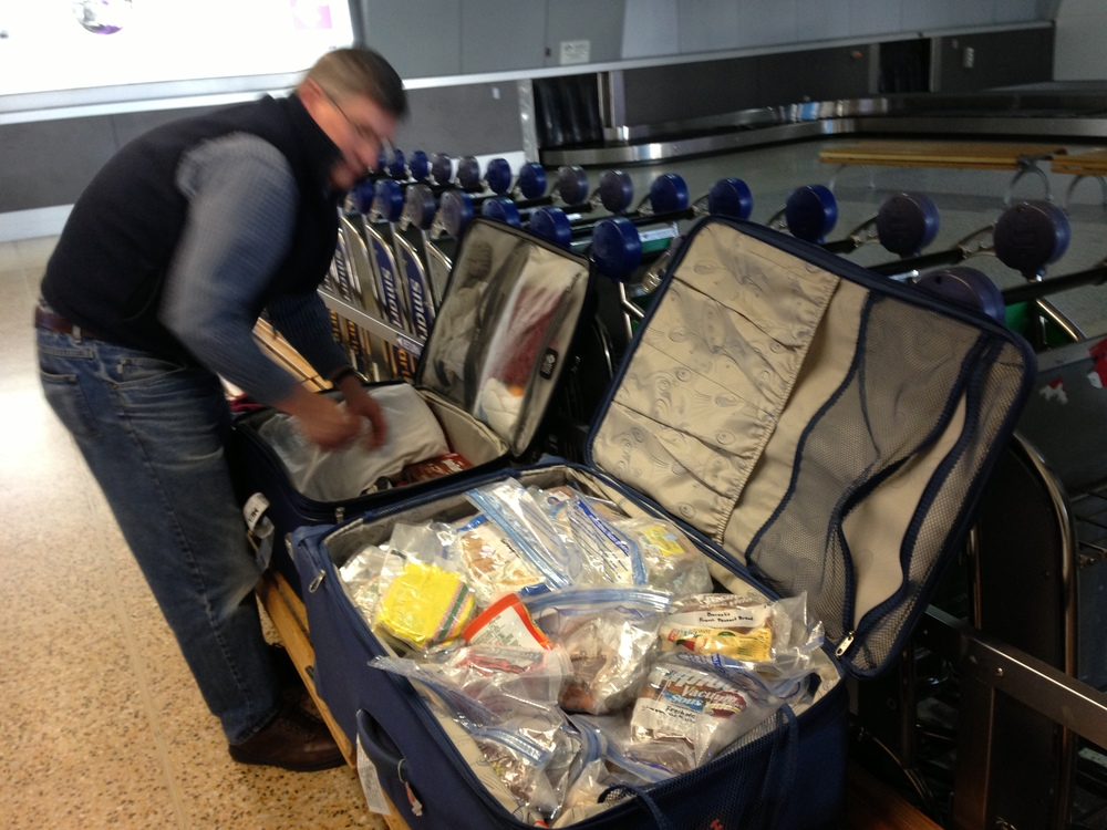 My husband, in the Sydney airport, rearranging the 80 loaves of U.S. bread that we hand carried to the lab at Monash. The research process takes a long time. FODMAP content of these breads has still not been published.